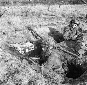 British_airborne_troops_man_a_trench_with_a_No._76_wireless_set_at_Heldon_in_Holland,_3_February_1945._B14347